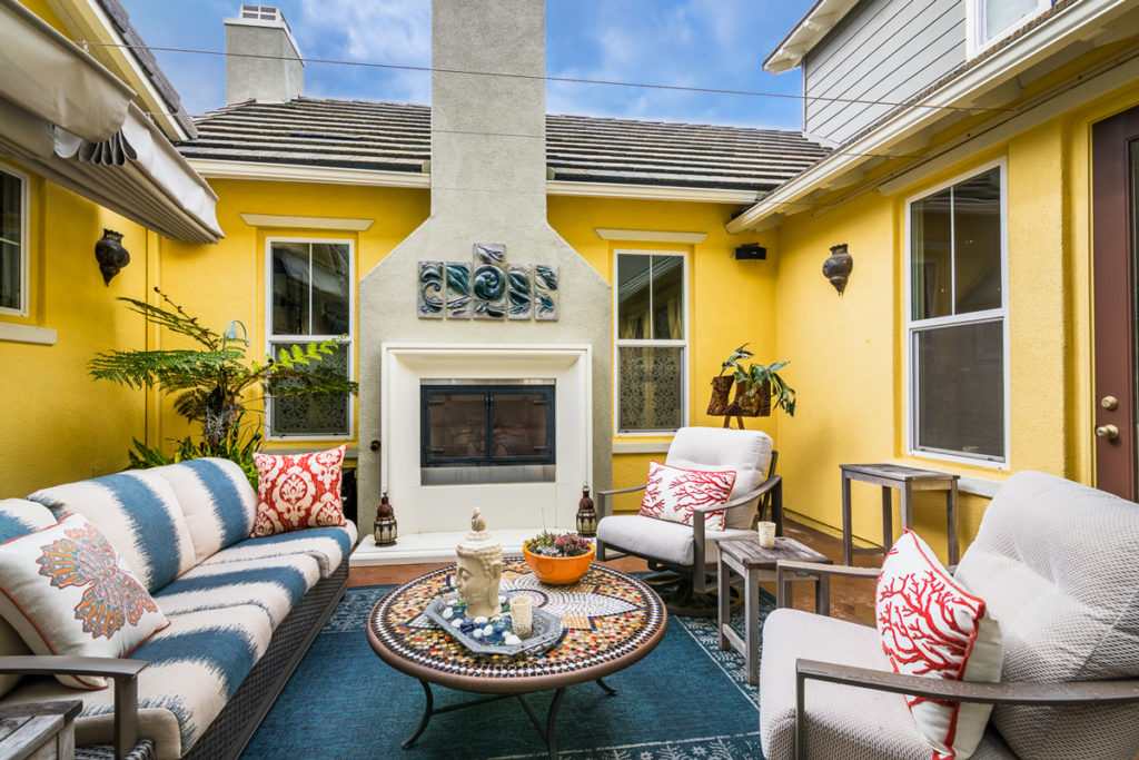 Eclectic-Courtyard-Outdoor-Fireplace-accent