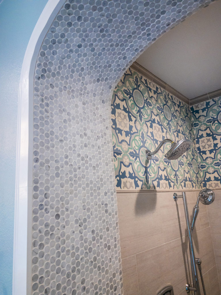 Moroccan-Inspired-tile-work-on-shower-arch-close-up